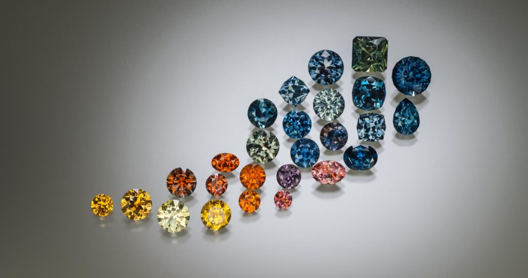 Figure 4. A selection of natural and heat-treated Rock Creek sapphire ranging from 0.50 to 4.70 ct. Photo by Jeff Scovil.