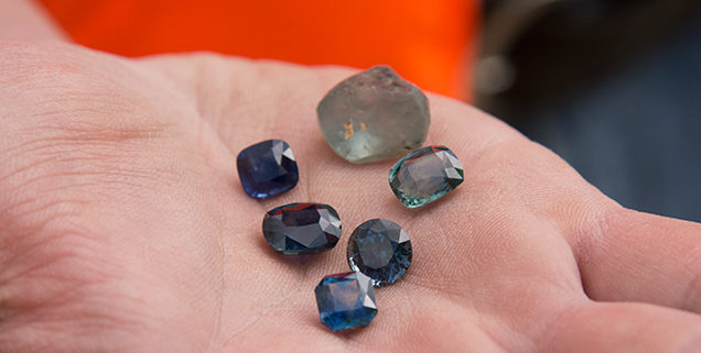 Beautiful faceted and rough sapphire from the new Rock Creek sapphire mine. Photo by Andrew Lucas/GIA.